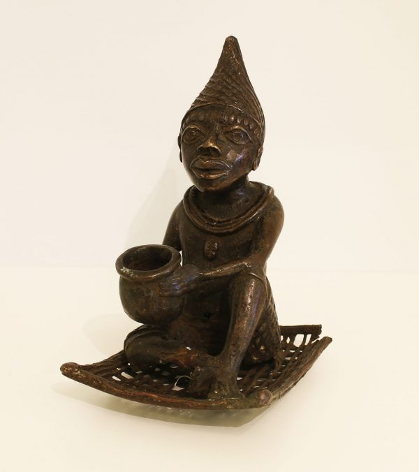 Benin. Ouidah. Bronze statue. Seated shaman/medicine man. 19th century.-0